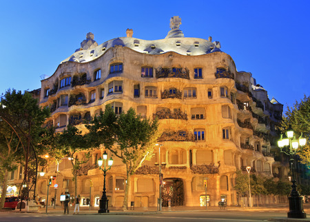 La Pedrera or Casa Mila at dusk, built during the years 1905-1910 and designed by Antoni Gaudi, Barcelona, Spain
