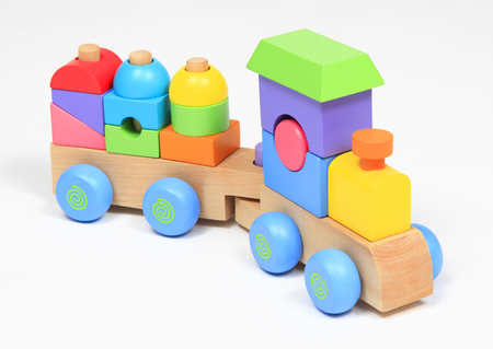 Colorful wooden train toy isolated over white