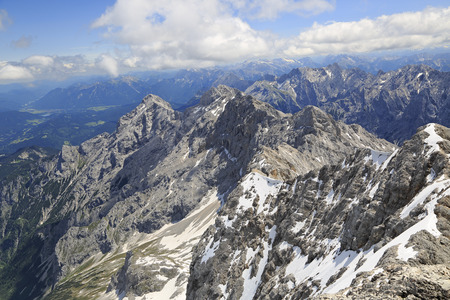 Alps mountains view from  the top of Zugspitze, Germany. The Zugspitze, at 2,962 m above sea level, is the highest peak of the Wetterstein Mountains