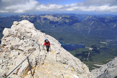 zugspitze mountain: Hiker near the summit of Zugspitze Mountain, the highest in Germany.