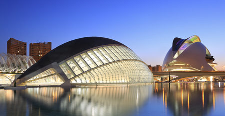 hemispheric: VALENCIA, SPAIN - JULY 23, 2017: Hemispheric building with reflections at dusk. The City of Arts and Sciences is an entertainment-based cultural and architectural complex and the the most important modern tourist destination in the city of Valencia.