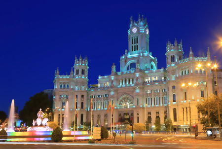MADRID, SPAIN - JULY 26, 2017:  The Plaza is a landmark of Madrid and it is famous for the Cybele Palace (City Hall), and the fountain of the same name. The illumination during the night is beautiful. Editorial