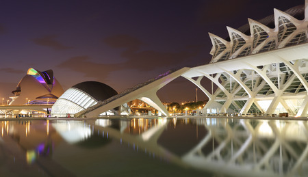hemispheric: VALENCIA, SPAIN - JULY 24, 2017: Hemispheric building with reflections at dusk. The City of Arts and Sciences is an entertainment-based cultural and architectural complex and the the most important modern tourist destination in the city of Valencia. Editorial
