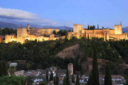Night photo of the Alhambra Palace, in Granada, Andalusia, Spain. A monument icon, the most visited in Spain Editorial