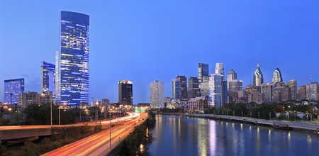 Philadelphia skyline illuminated at dusk and Schuylkill River, USA
