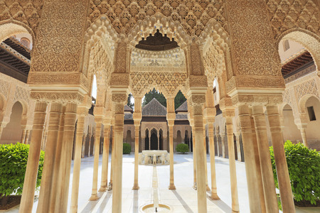 GRANADA, SPAIN - JUNE 29, 2017: Yard of the Lions in Alhambra, the complete Arabic form of which was Qalat Al-Hamra, is a palace and fortress complex located in Granada, Andalusia, Spain.