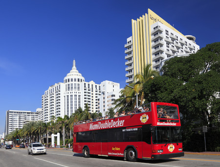MIAMI BEACH  FLORIDA: DECEMBER 29, 2017: Collins Avenue Art Deco skyline in Miami Beach and tourist Double Decker in the foreground Editorial