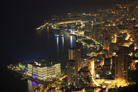 Monte Carlo illuminated at night in Monaco, Europe Stock Photo