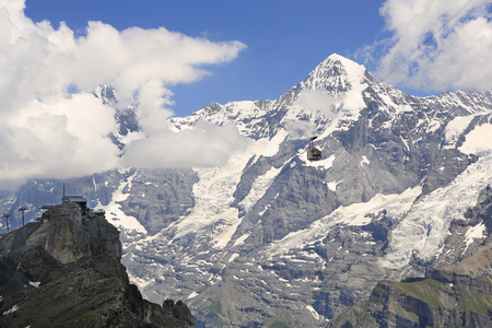 Schilthorn cable car with Birg station and Monch Mountain in Swiss Alps, Murren area