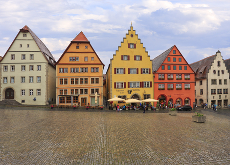 Tourists enjoying shopping, and architecture in Markplatz with traditional houses, Rothenburg ob der Tauber, Central Franconia, Bavaria, Germany