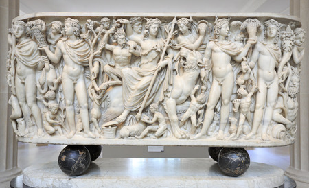 NEW YORK, USA - July 28, 2018: Roman sarcophagus marble relief sculpture including boy and goat from Metropolitan Museum.