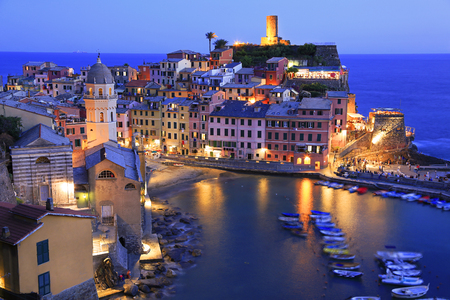 Aerial view of Vernazza vilagge illuminated at dusk on Mediterranean coast, Cinque Terre, Italy Stock Photo
