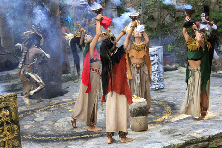 Pre-Hispanic Mayan amerindian people performance into the jungle in the ancient Mayan Village, Riviera Maya, Mexico