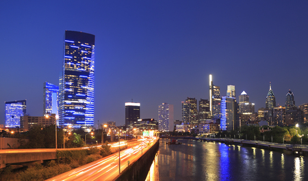 Philadelphia skyline at night with the Schuylkill River on the foreground Фото со стока
