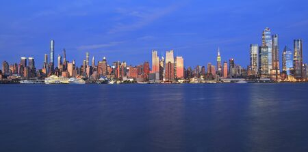 New York City skyline at dusk reflected in Hudson River, USA Фото со стока