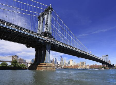Manhattan and Brooklyn Bridges with New York City skyline on the background, USA Фото со стока