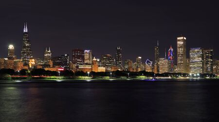 Chicago skyline at night with Lake Michigan on the foreground, IL, USA