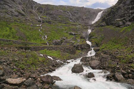Trollstigen waterfall and scenic mountain road in Norway, Europe
