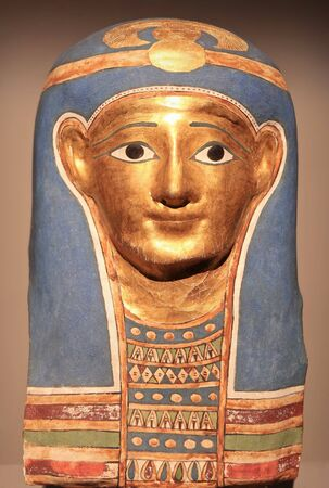 Egyptian Mummies Exhibition Exploring Ancient Lives at Montreal Museum of Fine Arts. Glided cartonnage mummy mask made in Late Ptolemaic-early Roman Period.