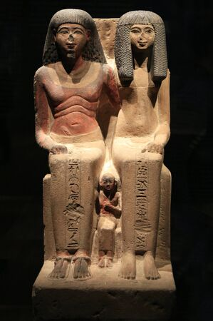 Egyptian Mummies Exhibition Exploring Ancient Lives at Montreal Museum of Fine Arts. Grup a statues of a Egyptian priest, his wife and their son. Editorial