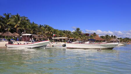Caribbean white beach including fishing boats in Riviera Maya, coast of Yucatan, Quintana Roo, Mexico