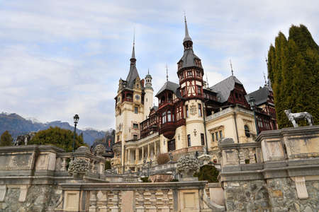 Famous Peles Castle and ornamental garden in Romania, landmark of Carpathian Mountains in Europe Editorial