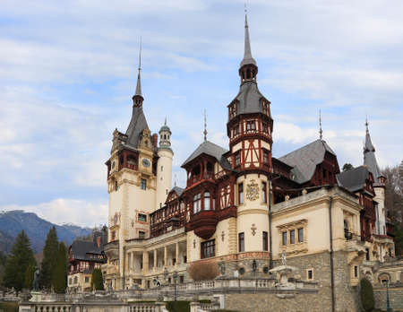 Famous Peles Castle and ornamental garden in Sinaia,  Romania, landmark of Carpathian Mountains in Europe