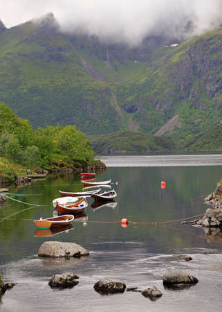 Fishing boat on a small fjord in Å village, Lofoten Islands, Norway 免版税图像