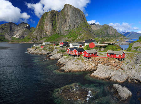 Traditional red Norwegian fishing huts on the border of the ocean, Hamnoy Island in Lofoten, northern Norway