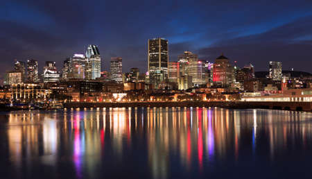 Montreal skyline illuminated at night with nice reflections in Saint Lawrence River, Quebec, Canada 新闻类图片