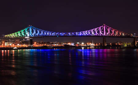 Jacques Bridge illuminated at night in Montreal, Canada