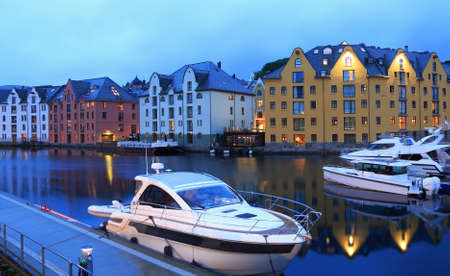 Alesund skyline architecture illuminated at dusk in Norway