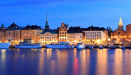 Stockholm's Old Town (Gamla Stan) reflected into the lake at dusk, Sweden