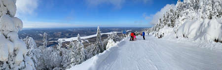 Panoramic aerial view of Mont Tremblant and Lake in winter ski season, Quebec, Canada