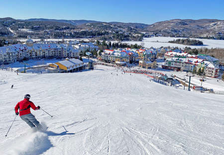 Skier on Mont Tremblant village resort, Quebec, Canada