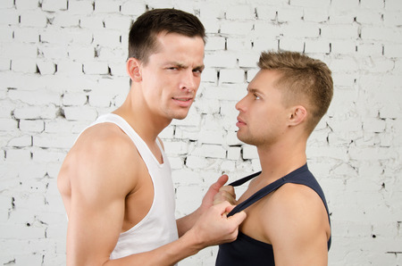Quarrels. Love and relationships. Two sexy guys.