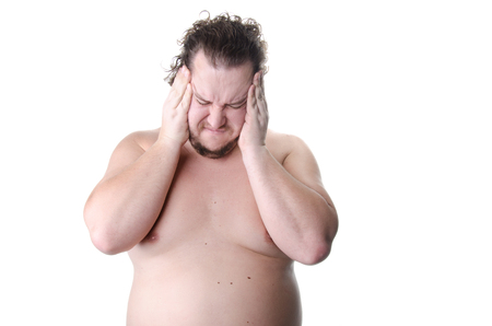 To think. Funny overweight guy without a shirt. White background. Stock Photo