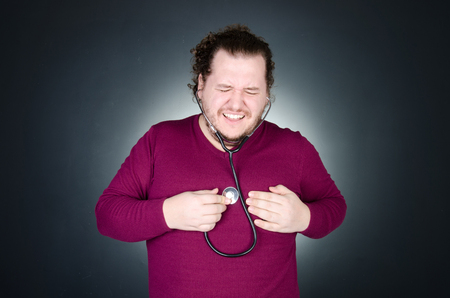 Heart attack. The overweight guy. Stock Photo
