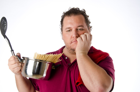allright: Cheerful funny cook. Kitchen tools. Fat guy. Pasta. Stock Photo
