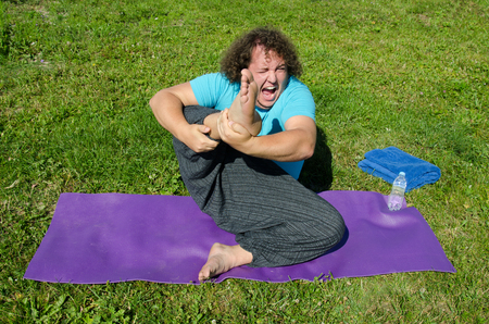 Funny fat man and yoga.