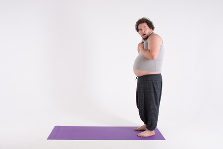 Funny fat man and yoga. Sport, diet and a healthy lifestyle.