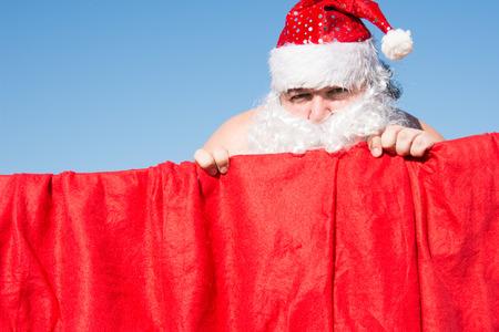 Funny Santa. Daily affairs. Preparing for the holiday. Banco de Imagens