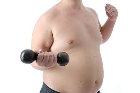 Fat man and gym. Stock Photo