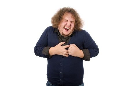 Work, stress, heart attack. Man and chest pain. Heartache. Unhealthy lifestyle and consequences. Stock Photo