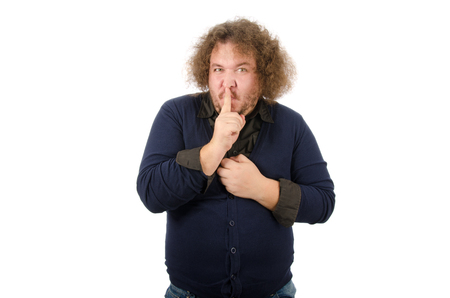 Secret. Funny guy says shh. Hush. Man requires silence. Stock Photo