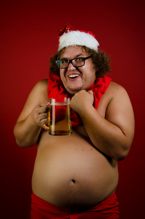 Funny naked Santa with beer.