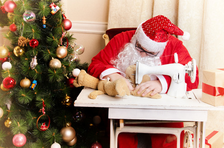 Santa Claus and sewing machine. Retro style. Christmas. Stock Photo
