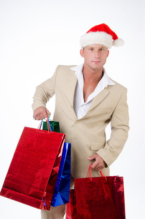 Business and gifts for Christmas. An attractive guy in a suit. Stock fotó