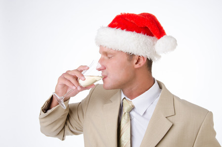 Corporate party. An attractive man is drinking champagne. Stock Photo