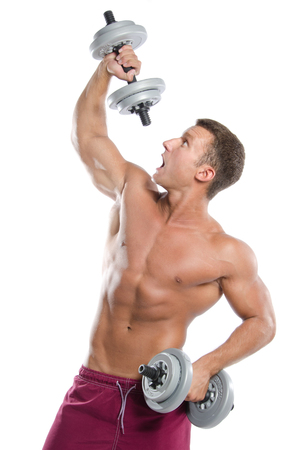 Fitness and healthy lifestyle. The man with dumbbells. Funny guy.